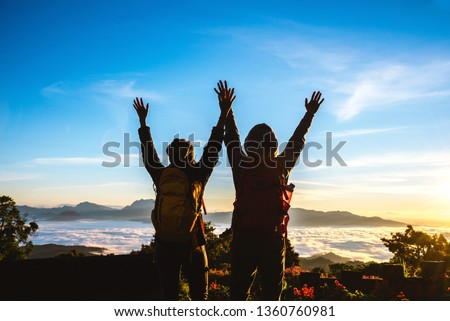 Asian couples Tourists with backpacks travel nature on the mountain,Travel relax. Natural Touch countryside. Thailand #1360760981