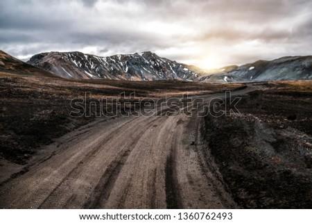 Beautiful Landmanalaugar gravel dust road way on highland of Iceland, Europe. Muddy tough terrain for extreme 4WD 4x4 vehicle. Landmanalaugar landscape is famous for nature trekking and hiking. #1360762493