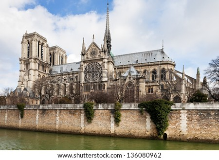 cathedral Notre-Dame de Paris and Seine River in cloudy day #136080962