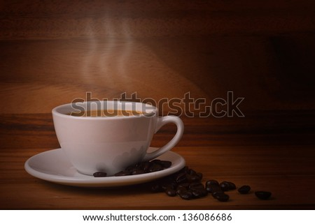 Coffee cup with coffee beans #136086686