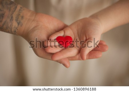 adult and child hands holding red heart, health care, donate and family insurance concept,world heart day, world health day, CSR concept #1360896188