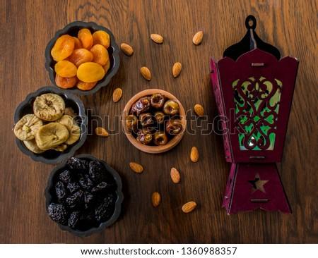 Dried Apricots,dried plums,dried fog,dates & nuts. Ramadan Background, Ramadan desserts & Muslim lamp #1360988357