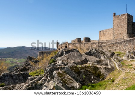 Marvao castle on the top of a mountain with beautiful green landscape behind on summer, in Portugal #1361036450