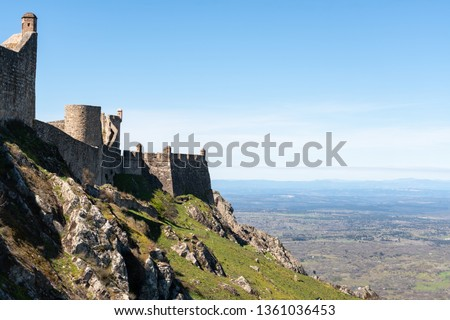 Marvao castle on the top of a mountain with beautiful green landscape behind on summer, in Portugal #1361036453