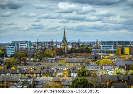 Slough ,England View of residential part of Slough. St Mary's church and modern Slough in the background . Aerial picture.