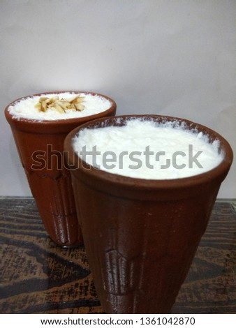 Two lassi is an authentic cold drink in summer season, made up of curd, milk and sugar. Different choices. #1361042870