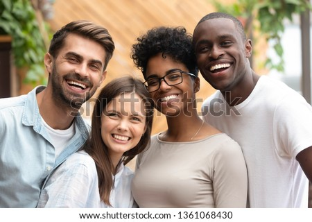 Happy multiracial friends group bonding looking at camera, young diverse people laughing having fun posing together, multi ethnic african and caucasian friendship reunion concept, head shot portrait #1361068430