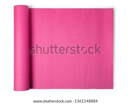 pink yoga mat Isolated on white background Royalty-Free Stock Photo #1361148884