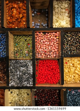 Colorful beads in various designs in wooden box for DIY ornaments #1361159699