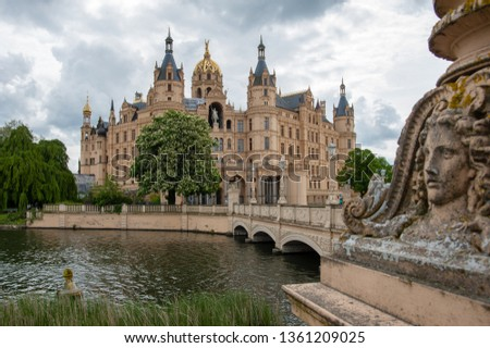 Schwerin, Germany - May 10, 2014: View at famous Schwerin castle with the golden dome, seat of federal state parliament of Mecklenburg-Vorpommern. #1361209025