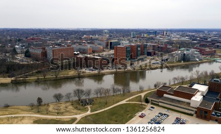 The college town of Iowas City is pictured here behind the Iowa River #1361256824