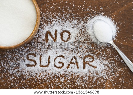 Sugar background sweet food ingredient with a close up of a pile of delicious white lumps of cubes as a symbol of cooking and baking and the diet health risks related to diabetes and calorie intake. #1361346698