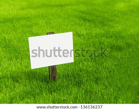 sign on a green meadow