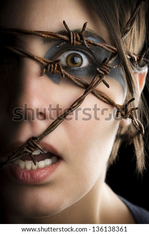 Terrified woman with barbed wire around the head. #136138361
