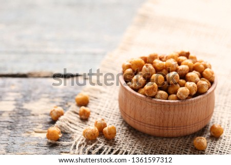 Roasted chickpeas in bowl on grey wooden table #1361597312
