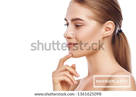 Rhinoplasty - nose surgery. Side view of attractive young woman with perfect skin and dotted lines on her nose isolated on white background. Plastic surgery concept #1361625098