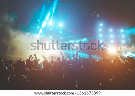 Happy people dancing and having fun in summer music festival party outdoor - Crowd of millennial guys celebrating concert event - Soft focus on center hand up with blue flare - Fun and youth concept #1361673899
