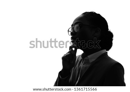 Silhouette of a thinking black woman. #1361715566