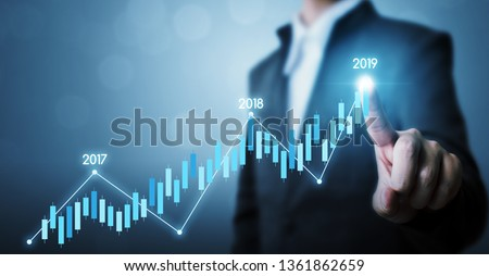 Business development to success and growing growth year 2019 concept, Businessman pointing line dot graph corporate future growth plan #1361862659