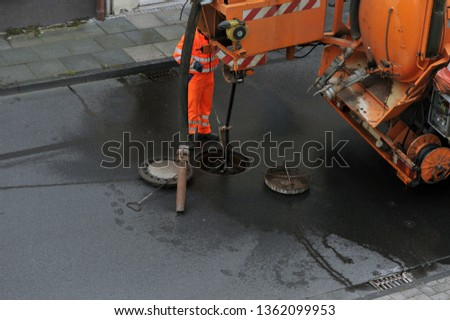 Sewer cleaning Sewage worker on cleans pipe