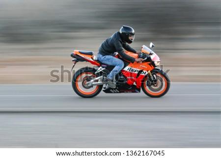 Iran, Fars, Arsanjan - March 27, 2019: a man riding a sport motorbike #1362167045
