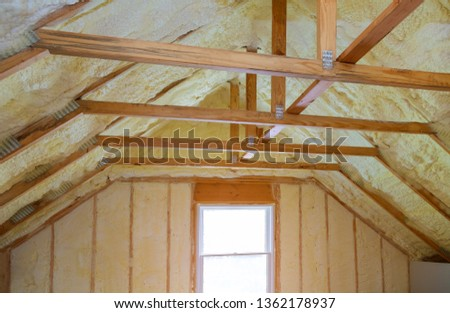 Insulation of attic with foam polyurea insulation cold barrier and insulation material #1362178937