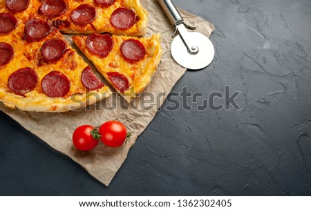 Tasty pepperoni pizza of tomatoes and ingredients on concrete background. Top view of hot pepperoni pizza.,copy space for your text #1362302405