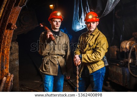 Miners in the process of working with tools in their hands. Coal mine. Two miners in the mine. Copy Space #1362400898