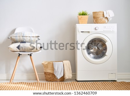 Interior of a real laundry room with a washing machine at home #1362460709
