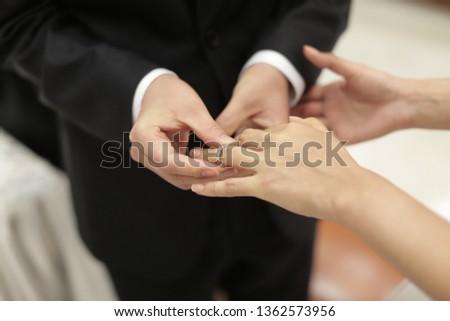 exchange rings in wedding ceremony #1362573956