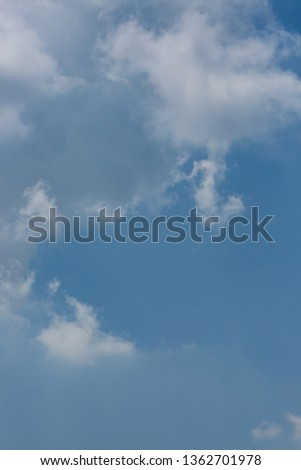 fluffy white cloud above clear blue sky background #1362701978
