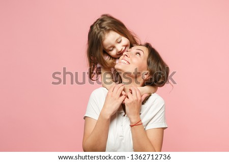 Woman in light clothes have fun with cute child baby girl. Mother, little kid daughter isolated on pastel pink wall background, studio portrait. Mother's Day love family, parenthood childhood concept #1362712736