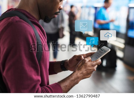 Black man using mobile phone at a platform #1362790487
