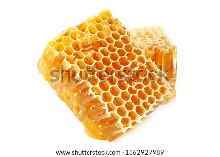 Yellow Honeycomb slice closeup isolated on white background Royalty-Free Stock Photo #1362927989