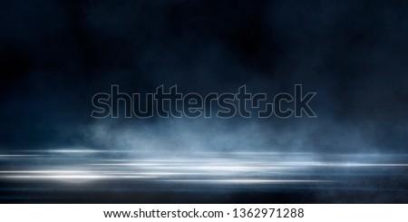 Wet asphalt, reflection of neon lights, a searchlight, smoke. Abstract light in a dark empty street with smoke, smog. Dark background scene of empty street, night view, night city. #1362971288