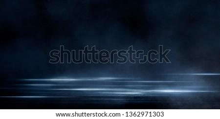 Wet asphalt, reflection of neon lights, a searchlight, smoke. Abstract light in a dark empty street with smoke, smog. Dark background scene of empty street, night view, night city. #1362971303
