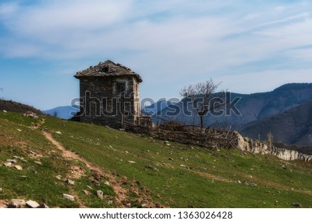 Old stone abandoned house in the mountain #1363026428
