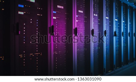 Shot of Dark Data Center With Multiple Rows of Fully Operational Server Racks. Modern Telecommunications, Cloud Computing, Artificial Intelligence, Database, Supercomputer. Pink Neon Light. #1363031090
