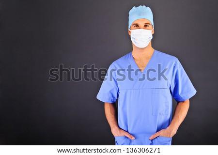 Doctor over dark background in blue shirt #136306271