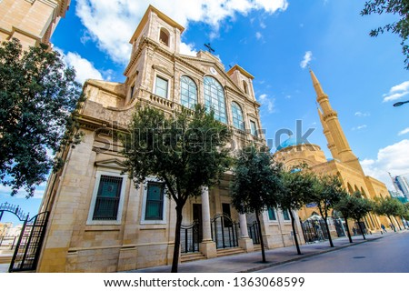 Church of Saint George Maronite and Mohammad Al-Amin Mosque coexist side by side in Downtown Beirut, Lebanon #1363068599