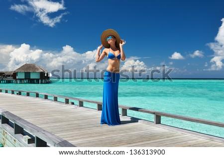 Woman on a tropical beach jetty at Maldives #136313900