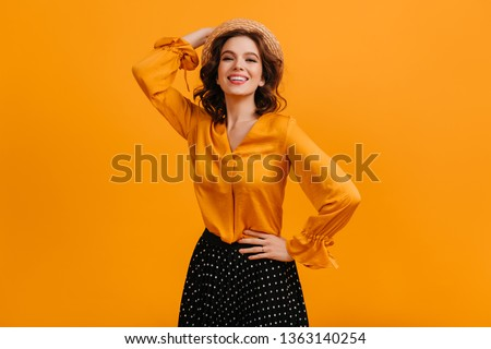 Confident girl laughing at camera. Studio shot of elegant white woman isolated on yellow background. #1363140254