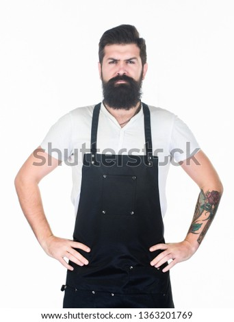 Bearded hipster wear apron. Man cook brutal hipster. Fast food restaurant. Serious bearded cook. Restaurant staff. Hipster professional barista apron uniform. Waiter or bartender. Ready serve drink. #1363201769