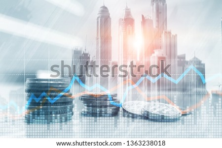 Double exposure of city and rows of coins with stock and financial graph on virtual screen. Business Investment concept. #1363238018