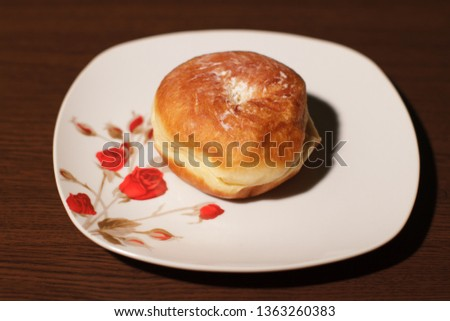 Donut on a plate #1363260383