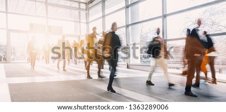 blurred business people at a trade fair Royalty-Free Stock Photo #1363289006