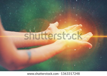 Woman hands praying for blessing from god, blurred nature background, rain, day. Religious human open empty hands with palms up. Gratitude, preacher worship, solitude pray, religion devotion concept #1363317248