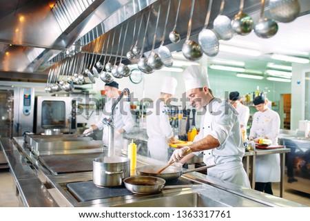 Modern kitchen. The chefs prepare meals in the restaurant's kitchen. #1363317761