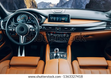 Modern suv car interior with leather panel, multimedia and dashboard #1363327418