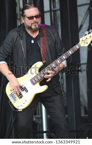 Speedway, IN/USA - May 26, 2017: Bass player Kenny Lee Lewis performs with the Steve Miller Band at an outdoor concert in Indiana. #1363349921